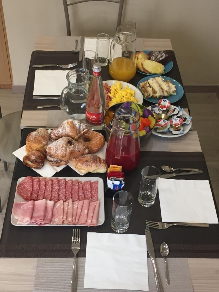 La colazione di QUISISTA EXCLUSIVE B&B